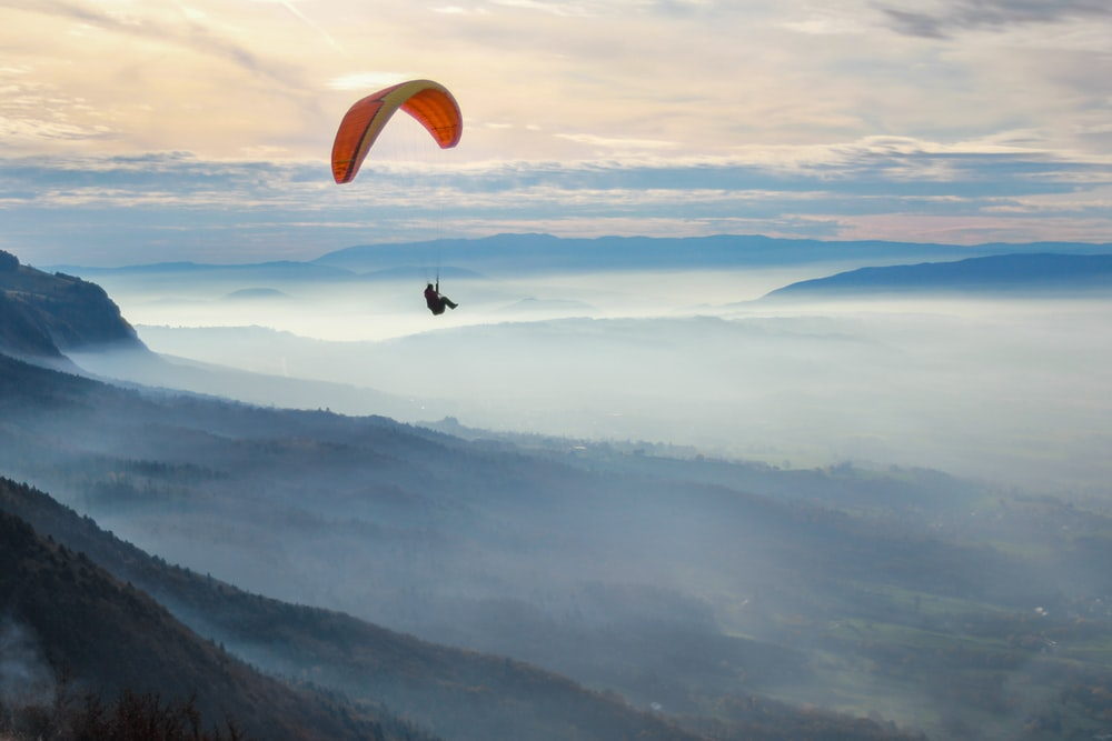 unknown person paragliding