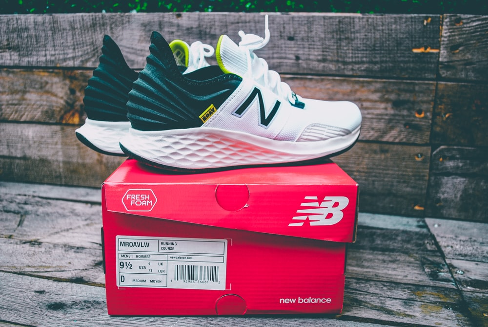 pair of black-and-white New Balance shoes on box photo – Free ...