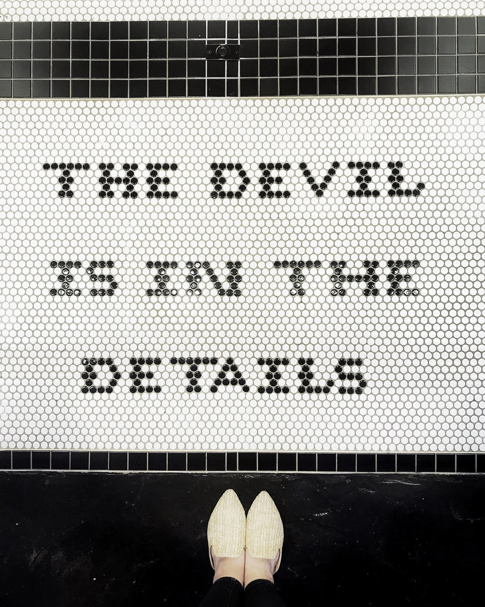 the devil is in the details signage