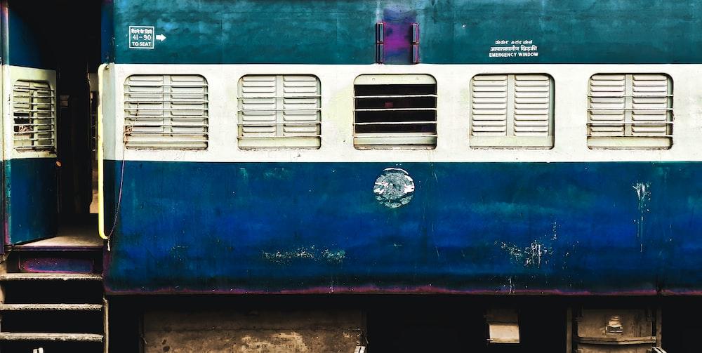 blue, white, and green train coach