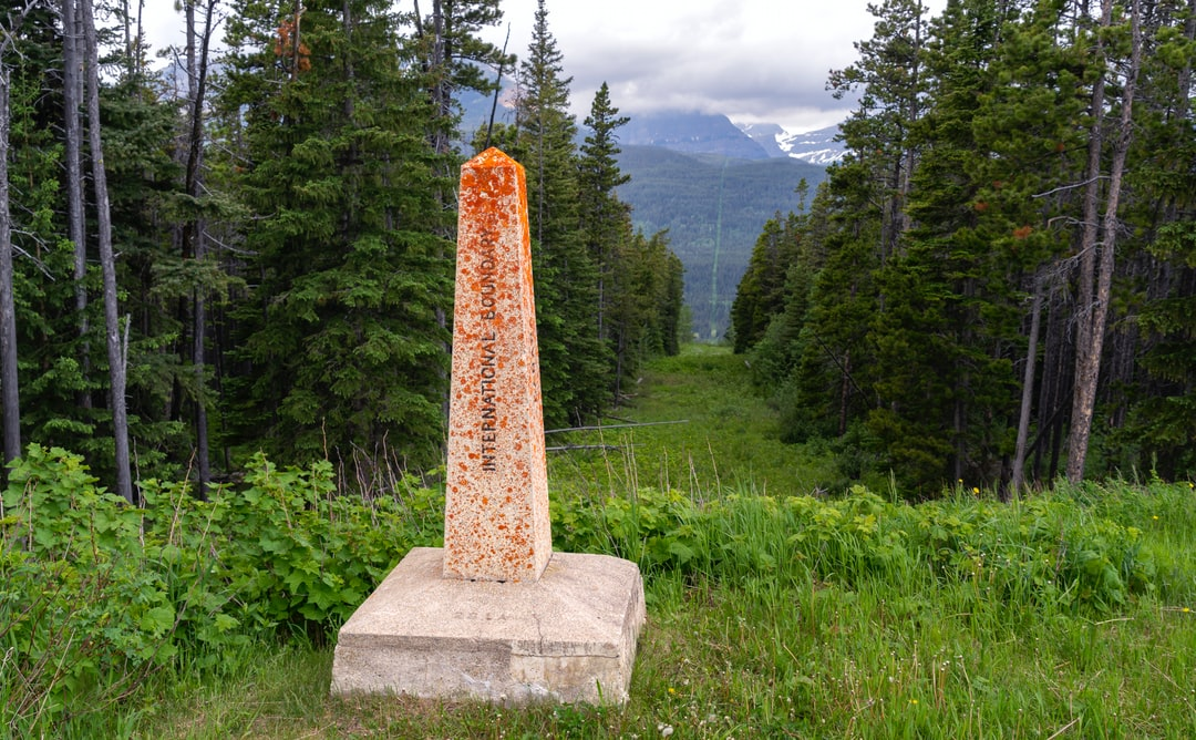 """On the east side of Glacier National Park, there is a border crossing from Montana in the US to Alberta on the Canadian side. While you wait for the immigration officer, you get a good view of the US/Canadian border, and you wonder, """"Who has to mow this thing?"""""""