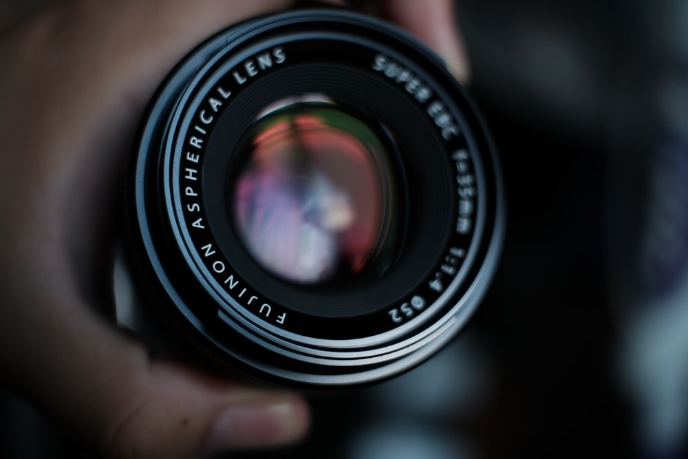 selective focus photo of white and black camera lens