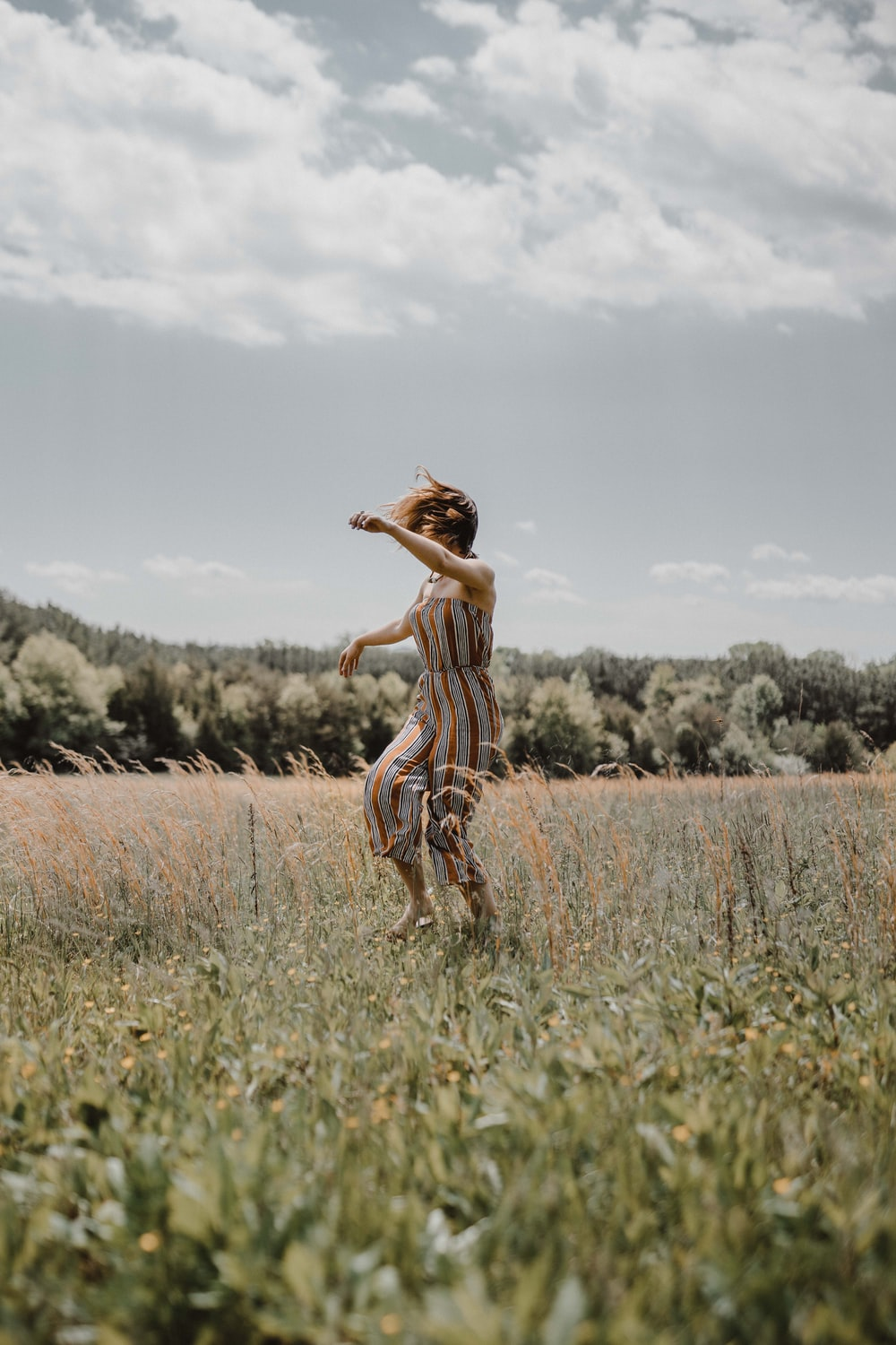 woman in grass field during daytime