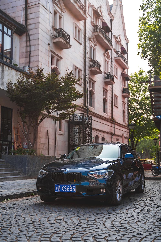 blue sedan on gray pathway