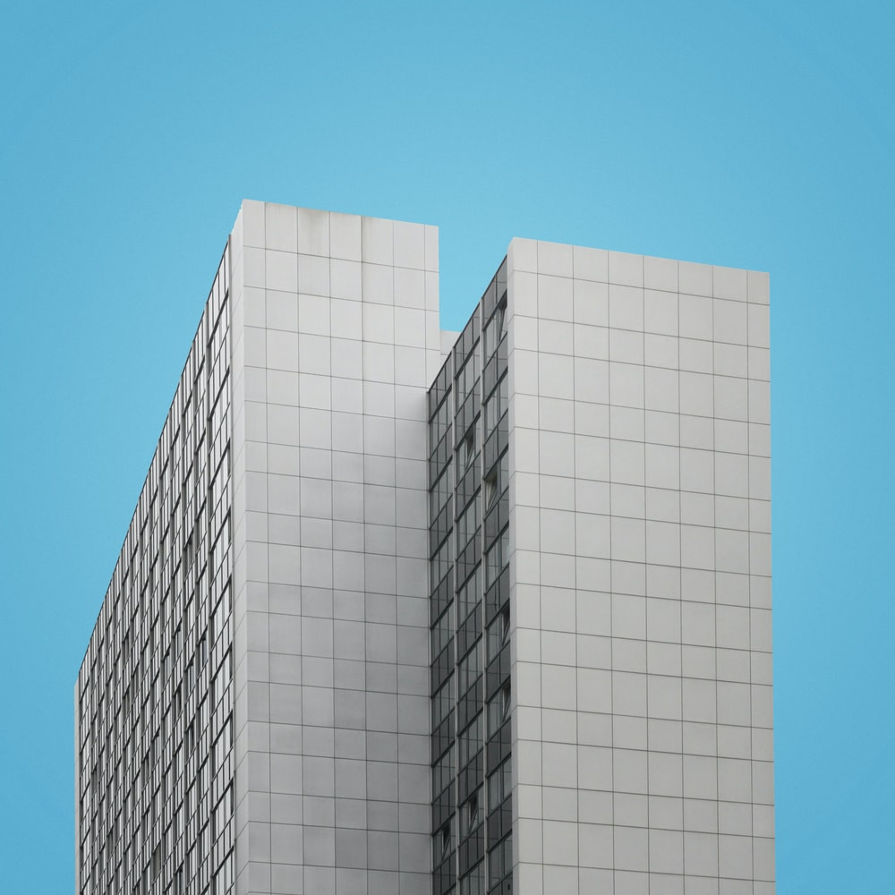 two white concrete high-rise buildings