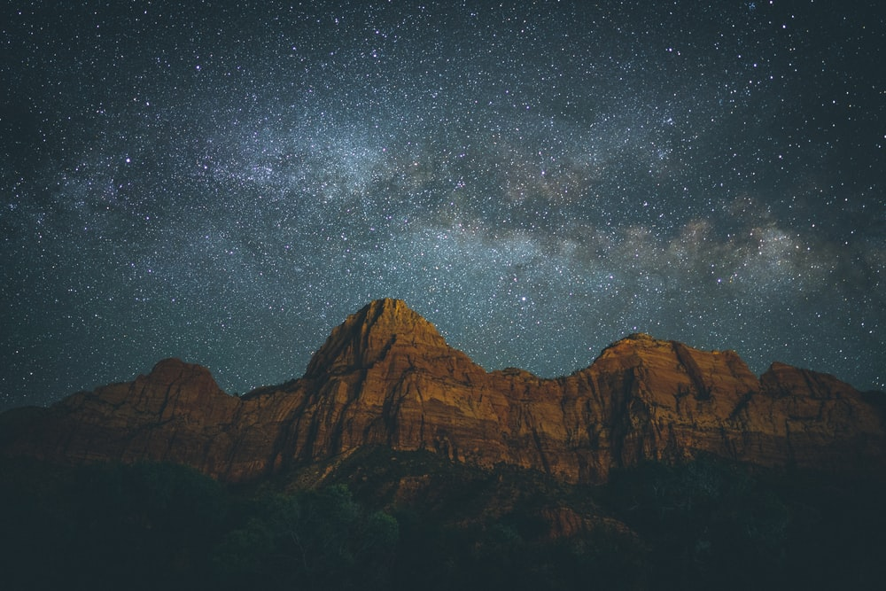 landscape photo of mountain under starry night