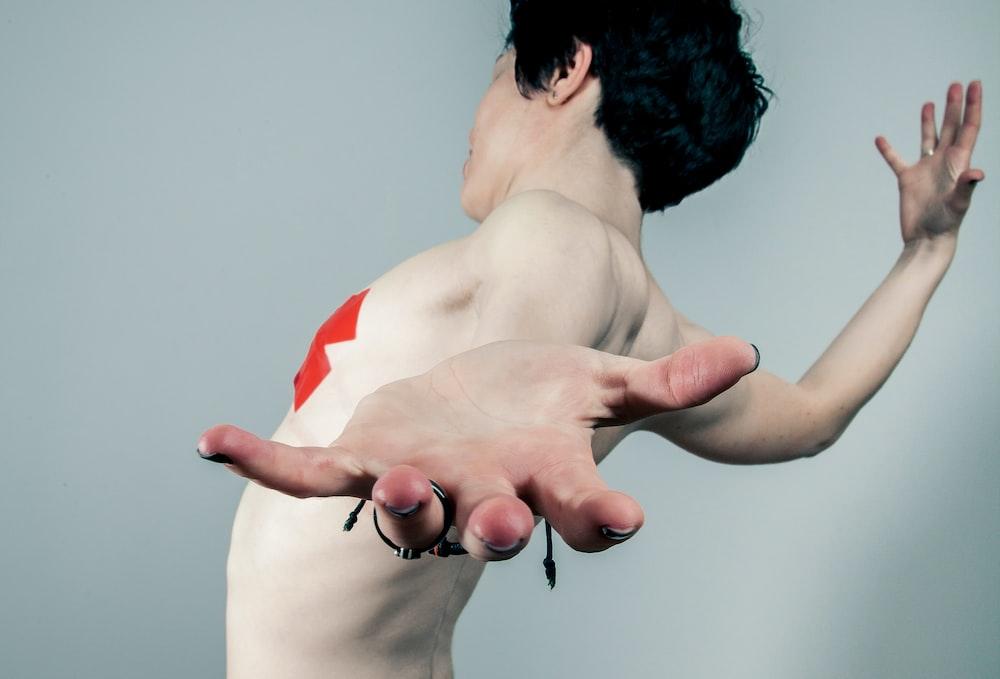 man spreading arms
