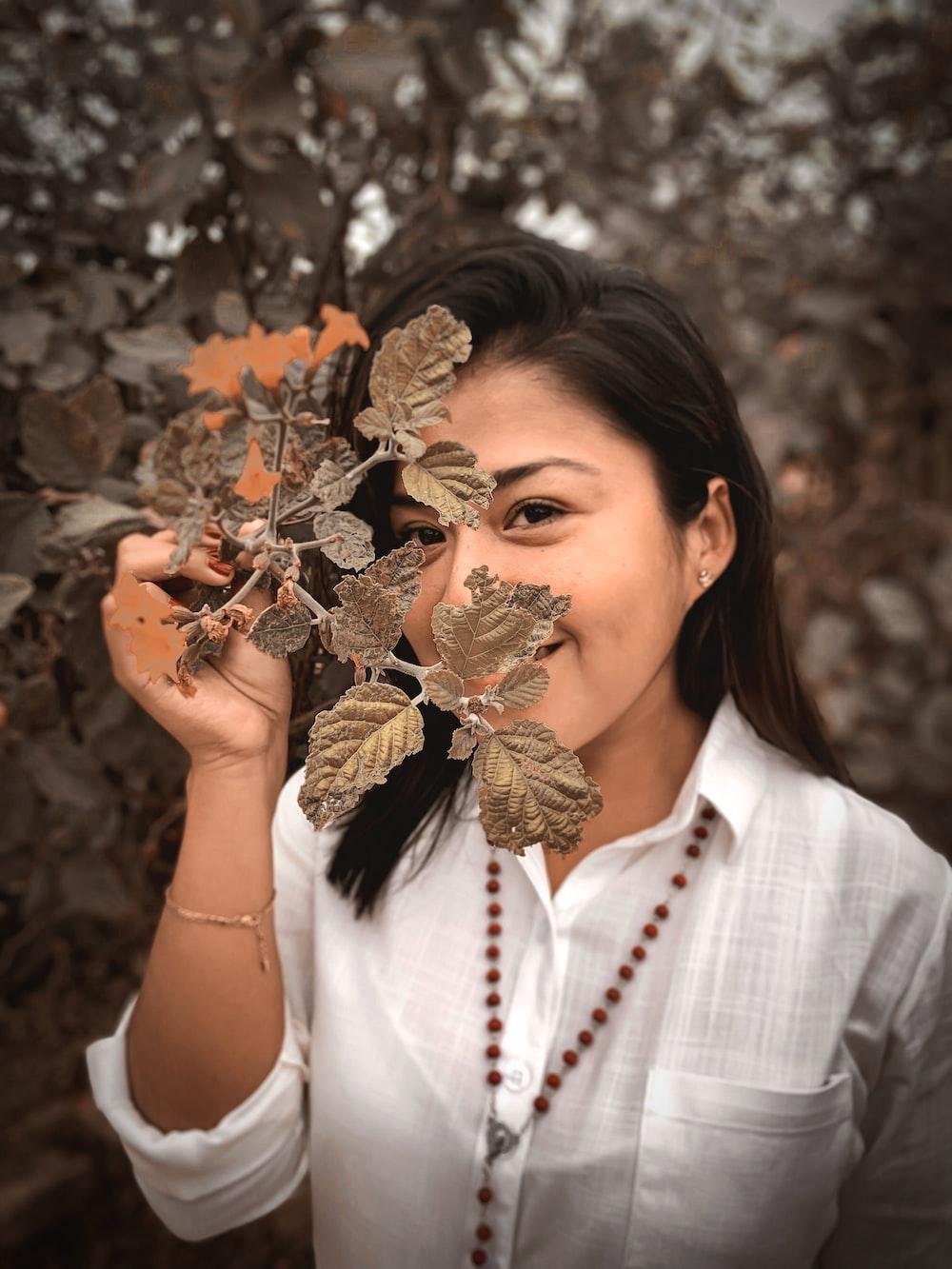 woman wearing brown leaf plant
