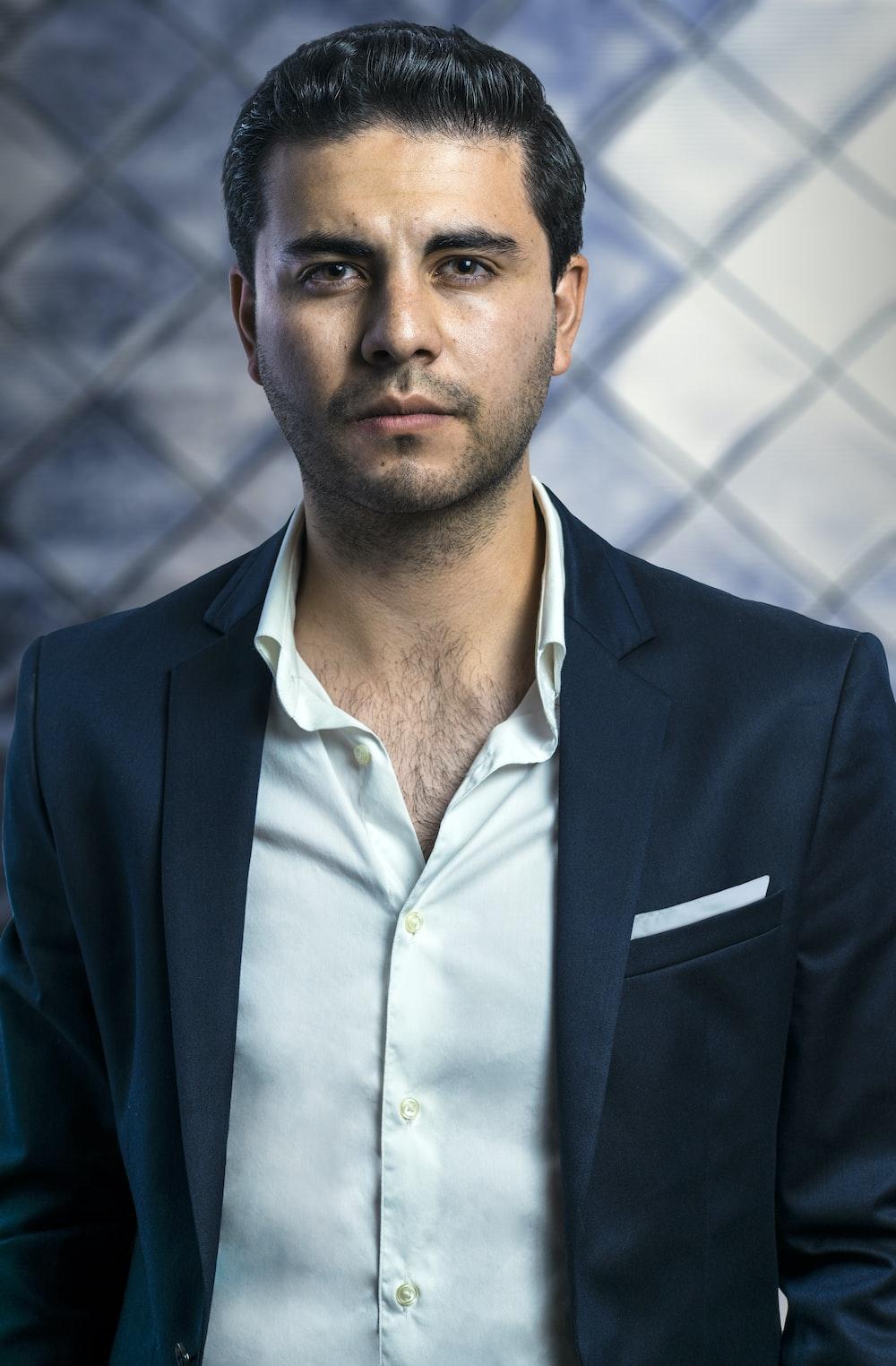 man in black notched lapel suit jacket