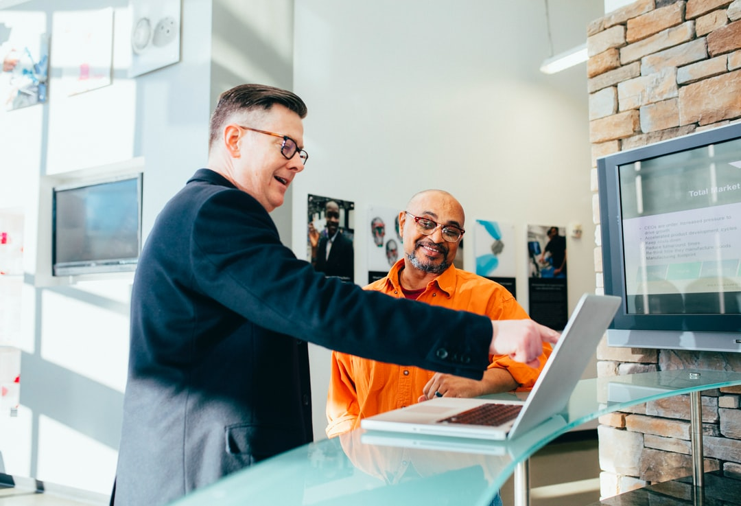 digital marketer using laptop to show client positive ROI