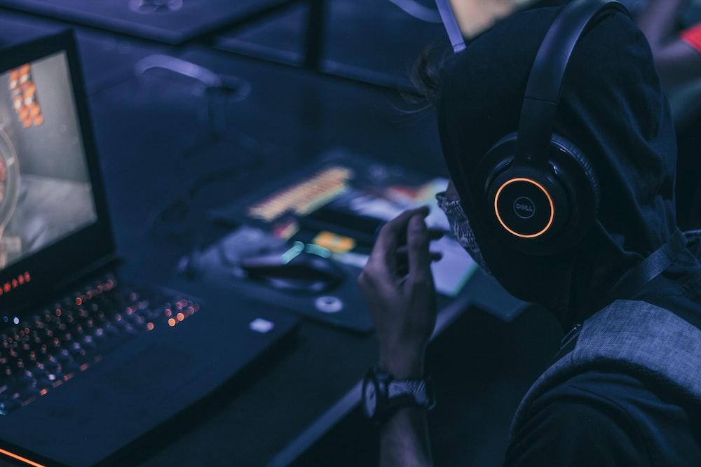 man playing on gaming lapto p