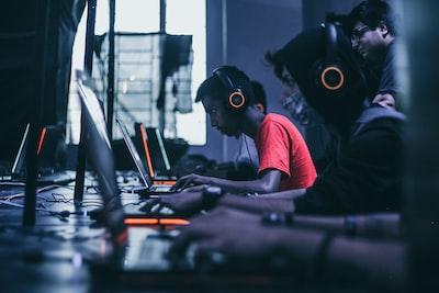 man playing on laptop gaming teams background