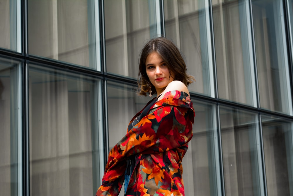 woman wearing orange and multicolored floral jacket