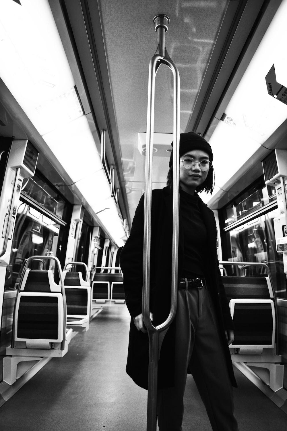 greyscale photo of woman in train