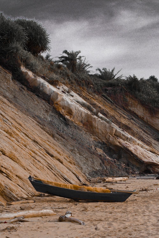 gray canoe near mountain