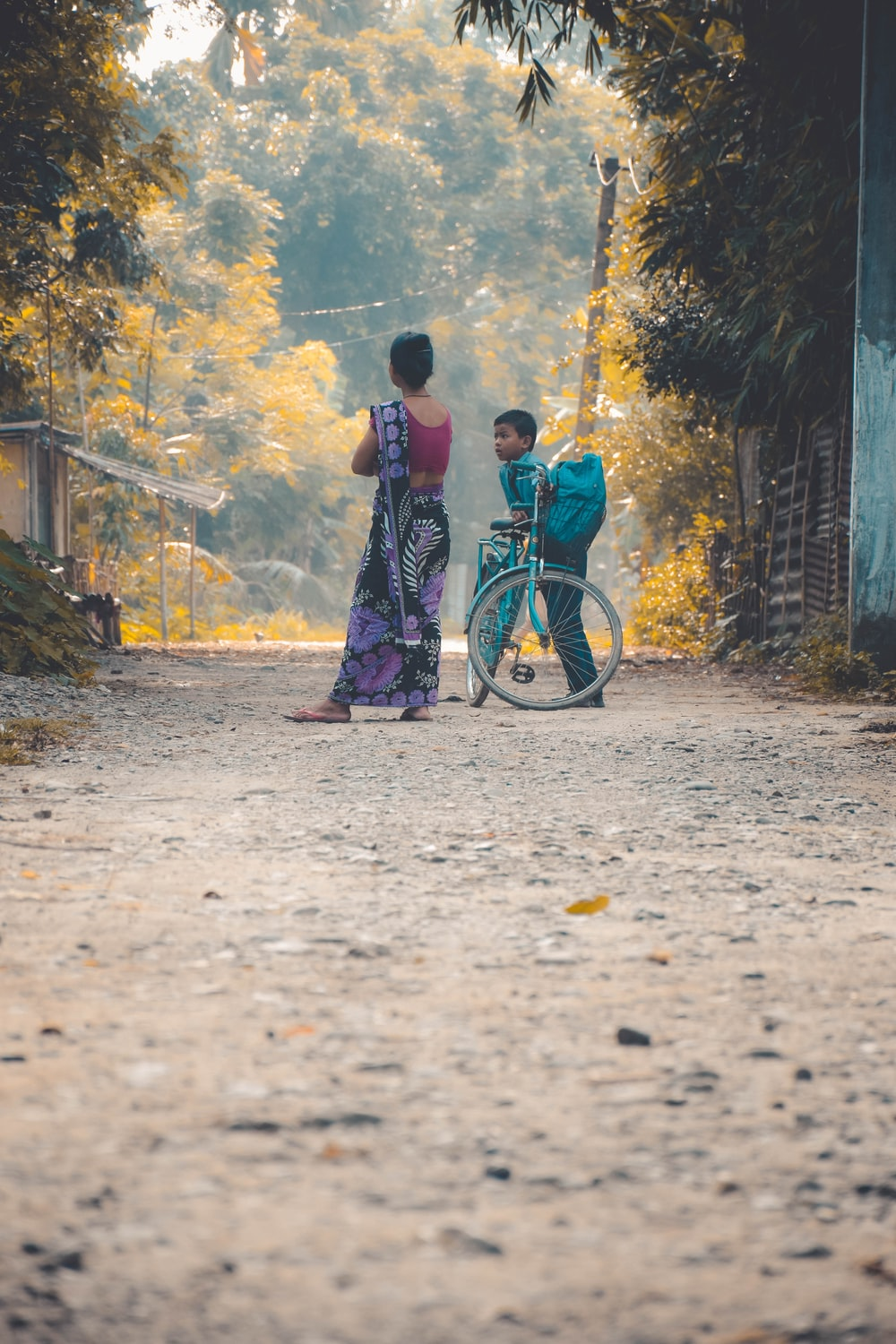 boy and woman standing on pathway