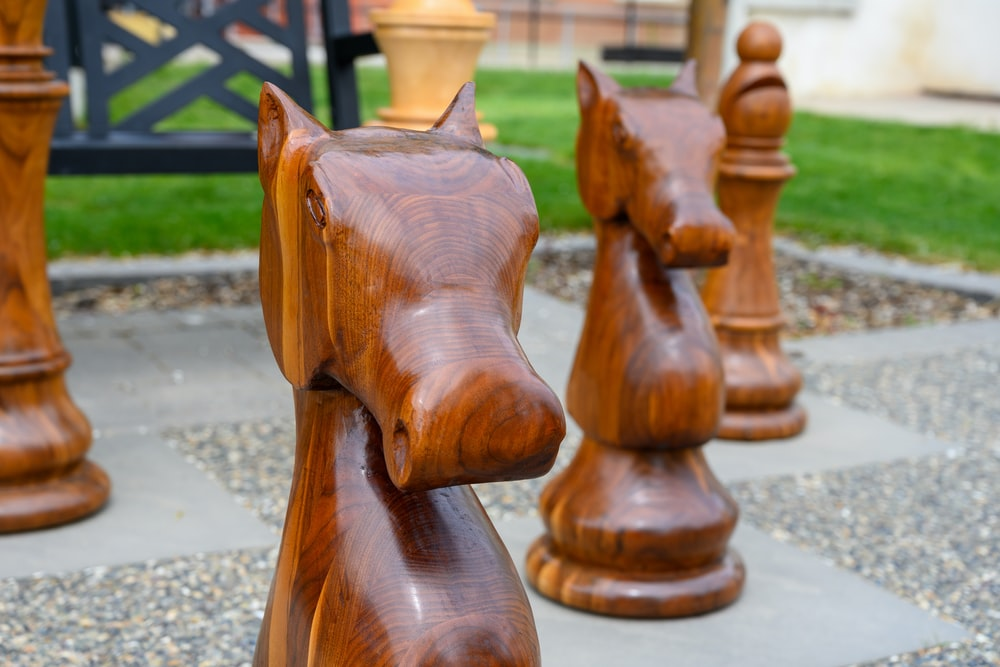brown wooden chess piece