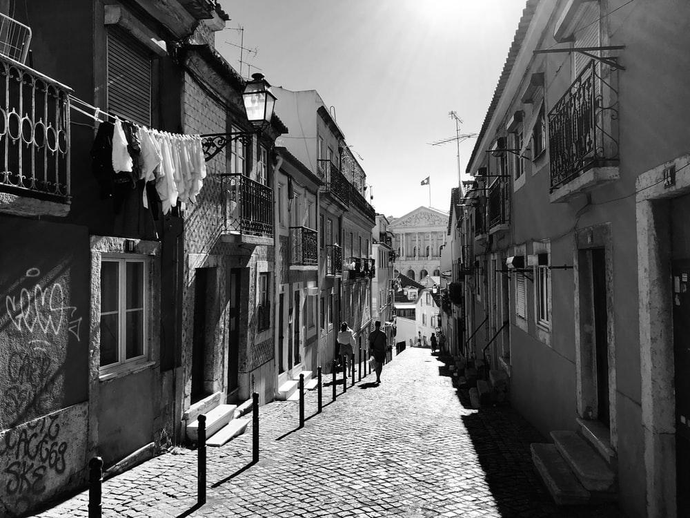 grayscale photo of street between