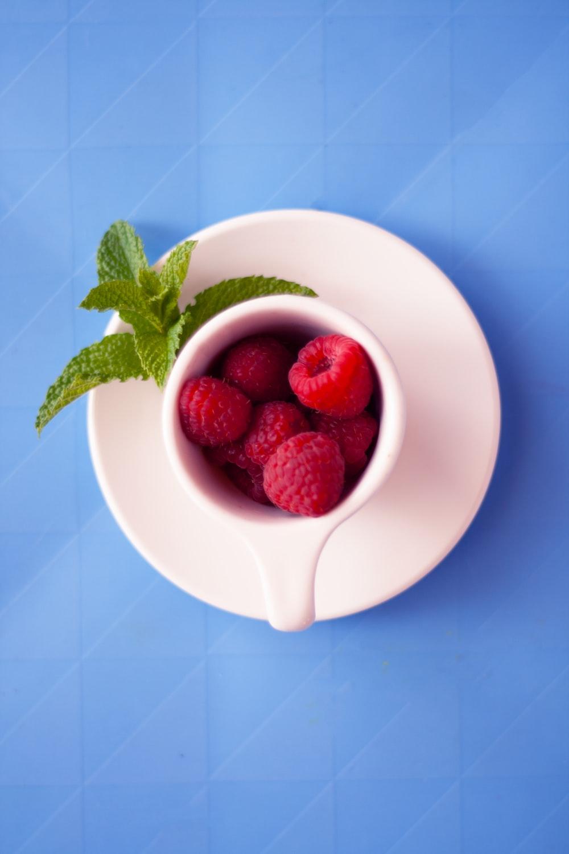 red raspberries on mug