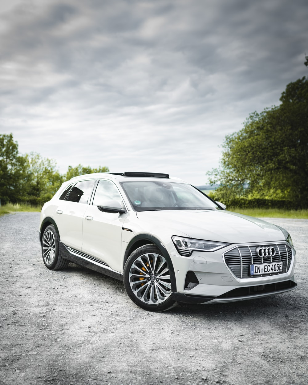 white Audi sedan on concrete road