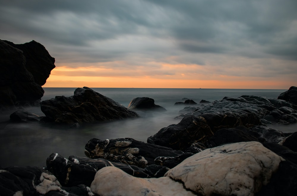 rocks under cloudy sky