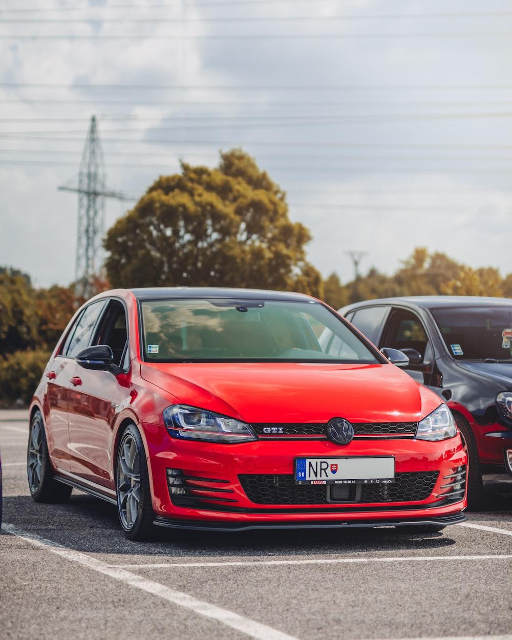 red Volkswagen Golf GTI 5-door hatchback in parking lot