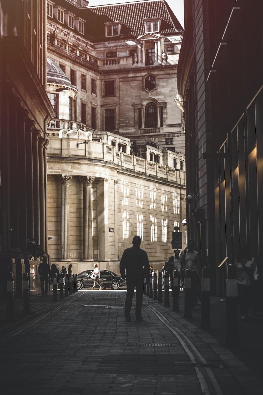 man walking on street during daytime