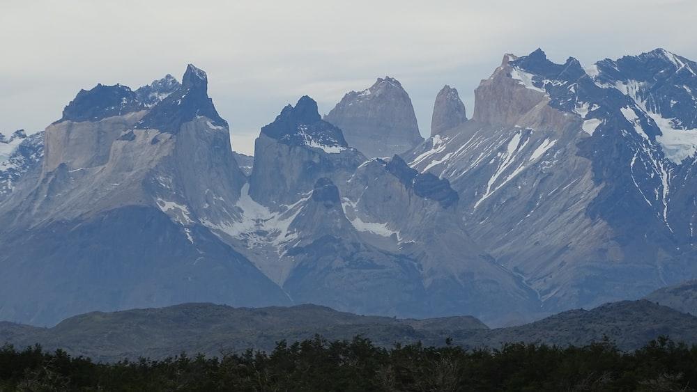 white snow capped mountain peaks in horizon