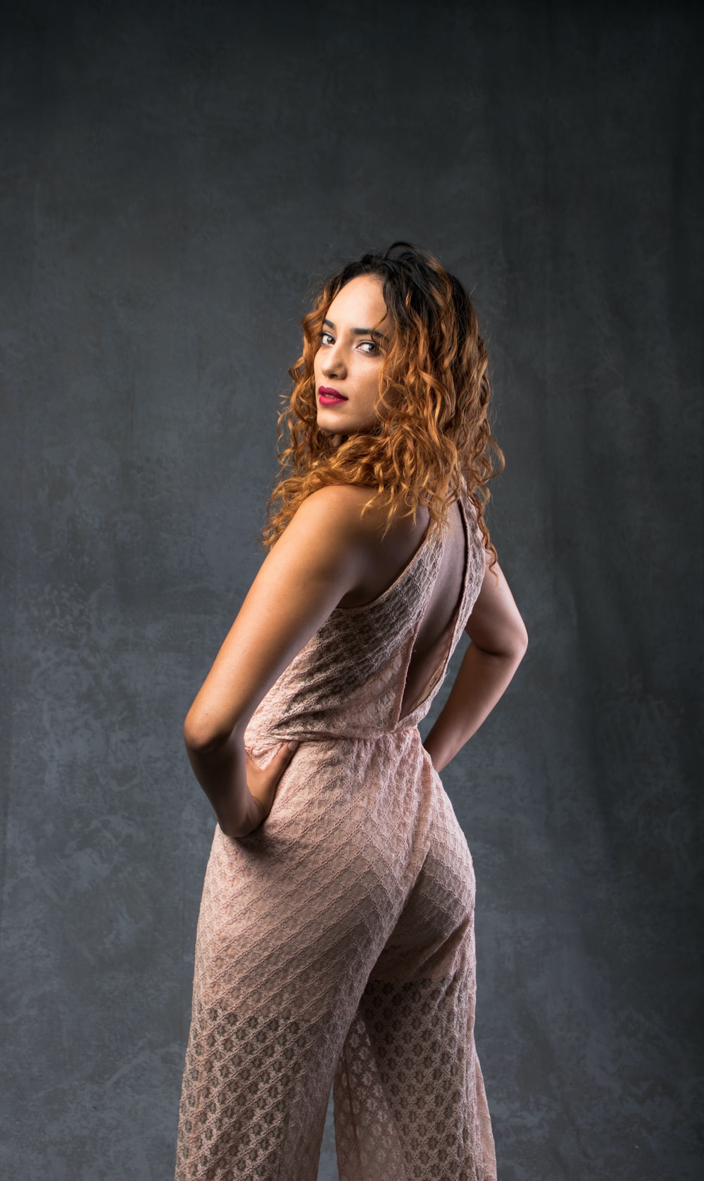 woman posing near black curtains