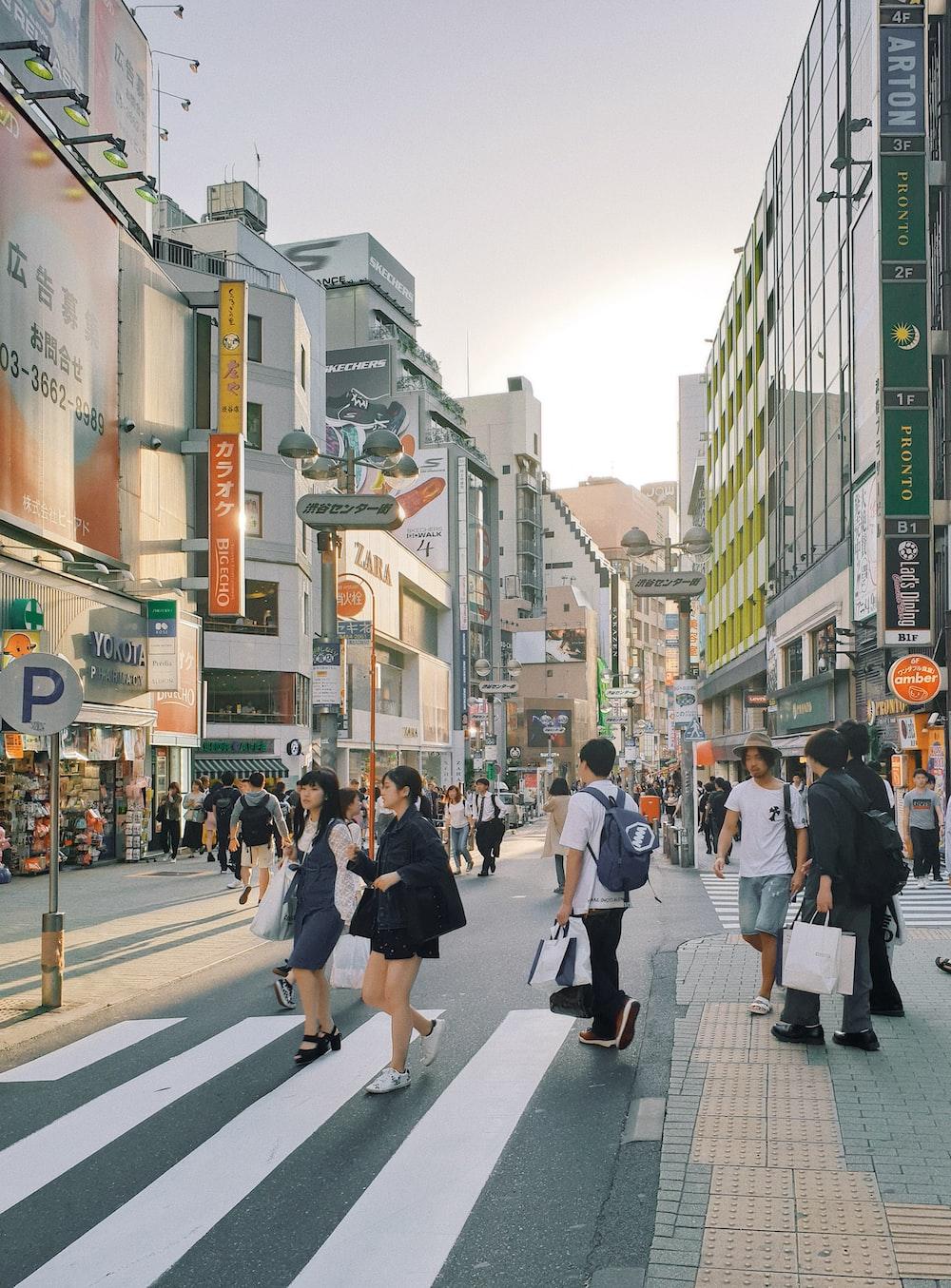 people walking on roadside during daytime
