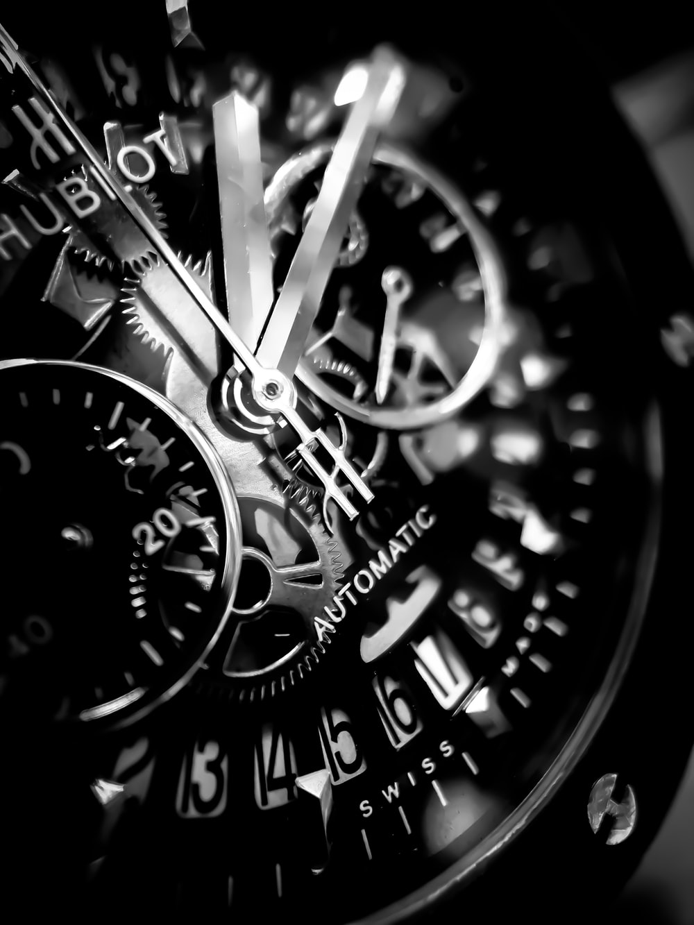 grayscale photo of Hublot chronograph watch displaying 01:10 time