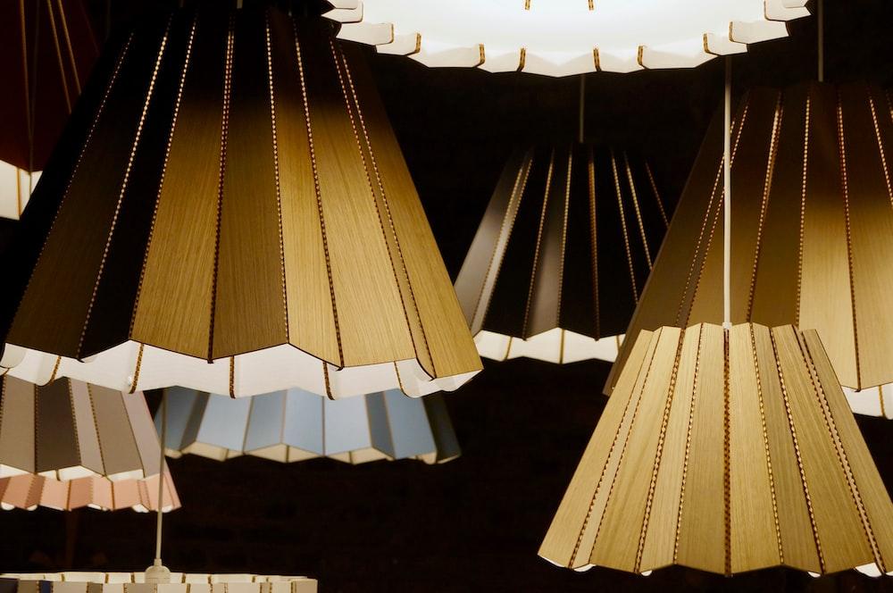 brown wooden pendant lamps