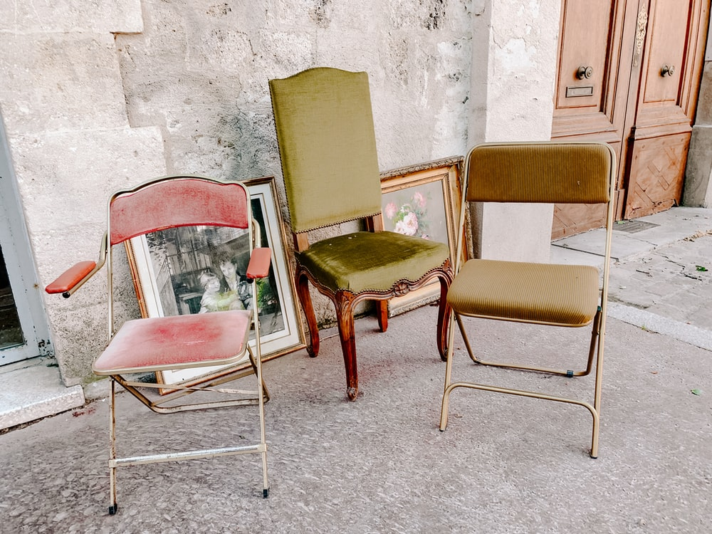 three assorted-color padded chairs