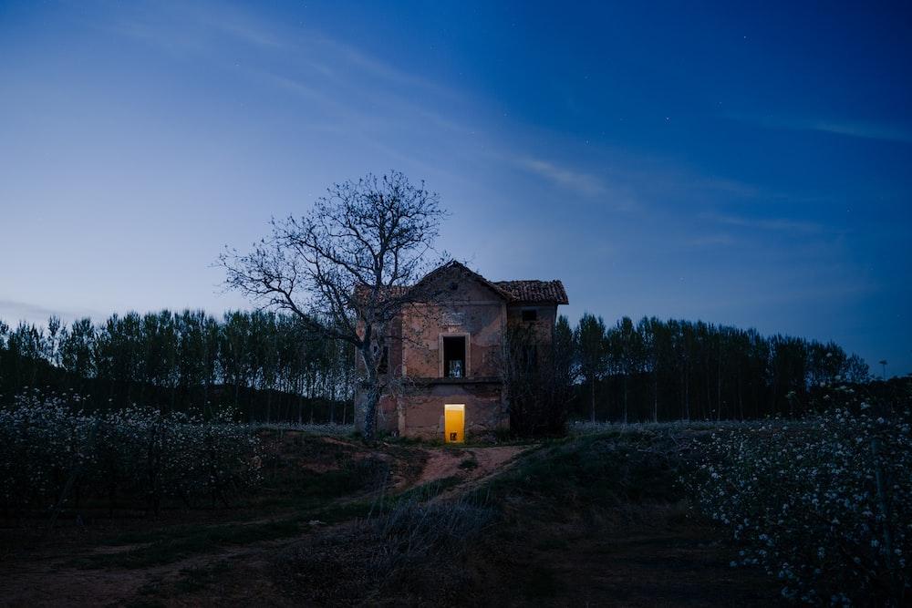 red brick house at dusk