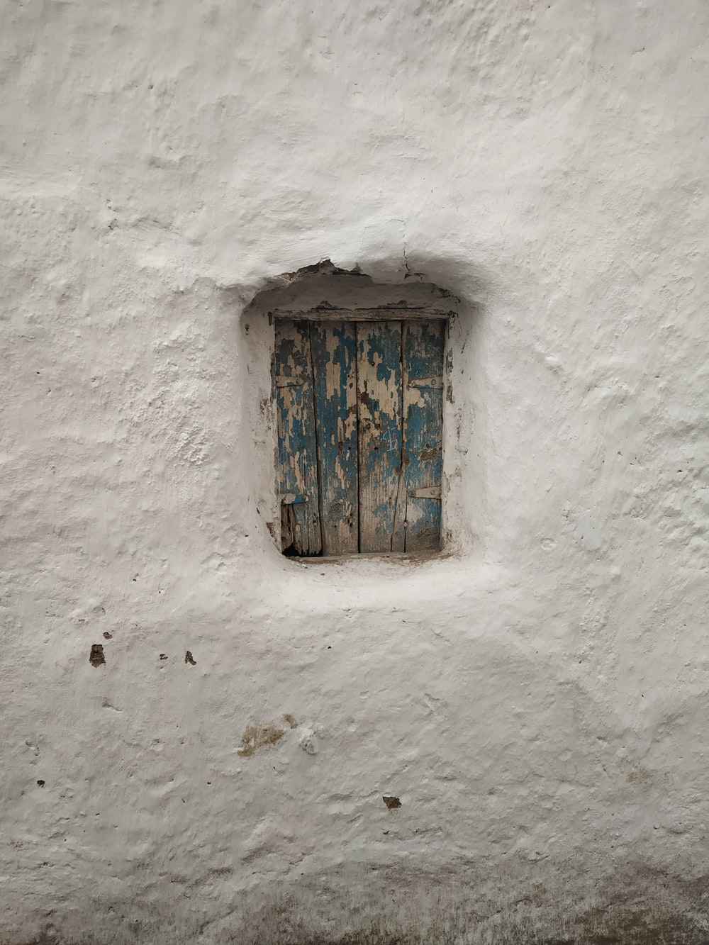 blue and white painted wooden window