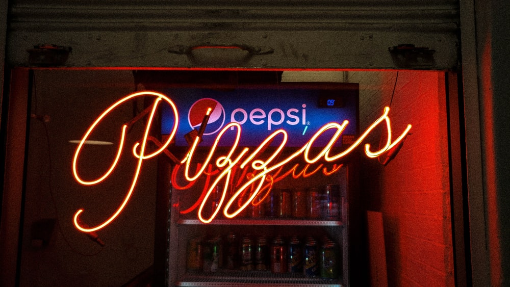 lighted pizzas neon light signage