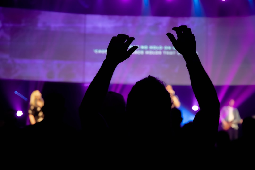 Man worshipping God at Relevant Church