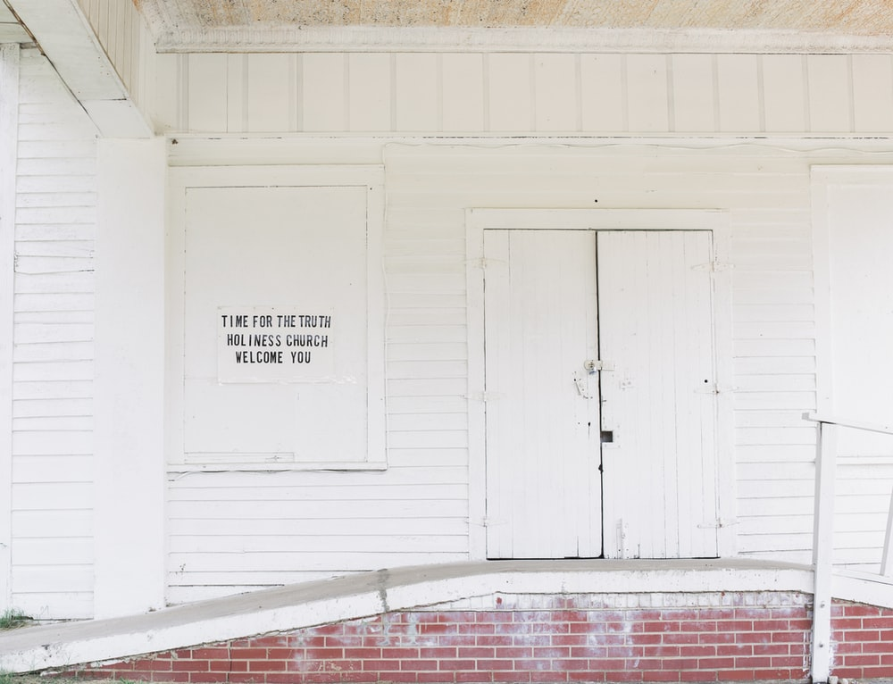 white wooden door near ramp