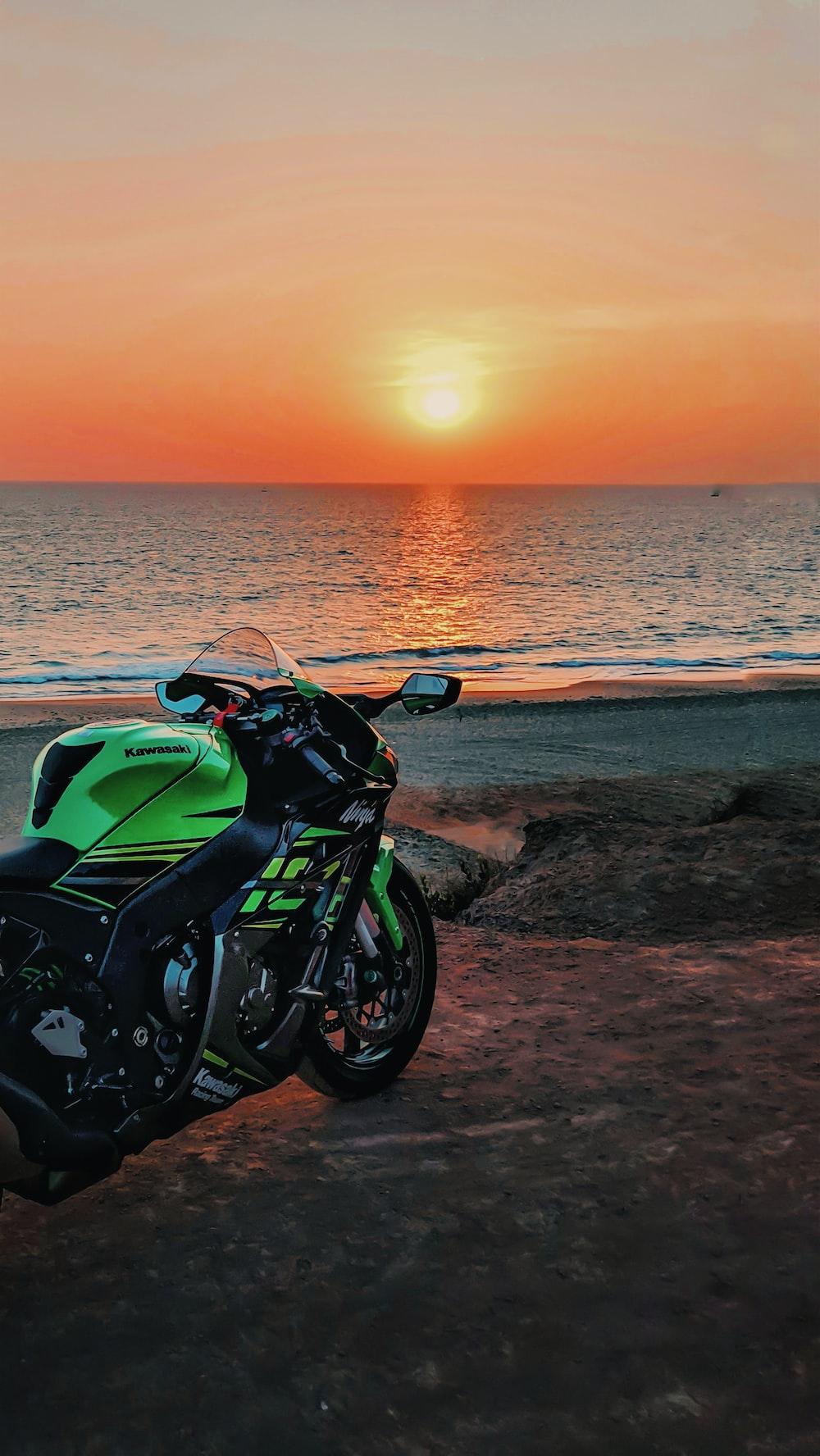 green and black Kawasaki Ninja seaside