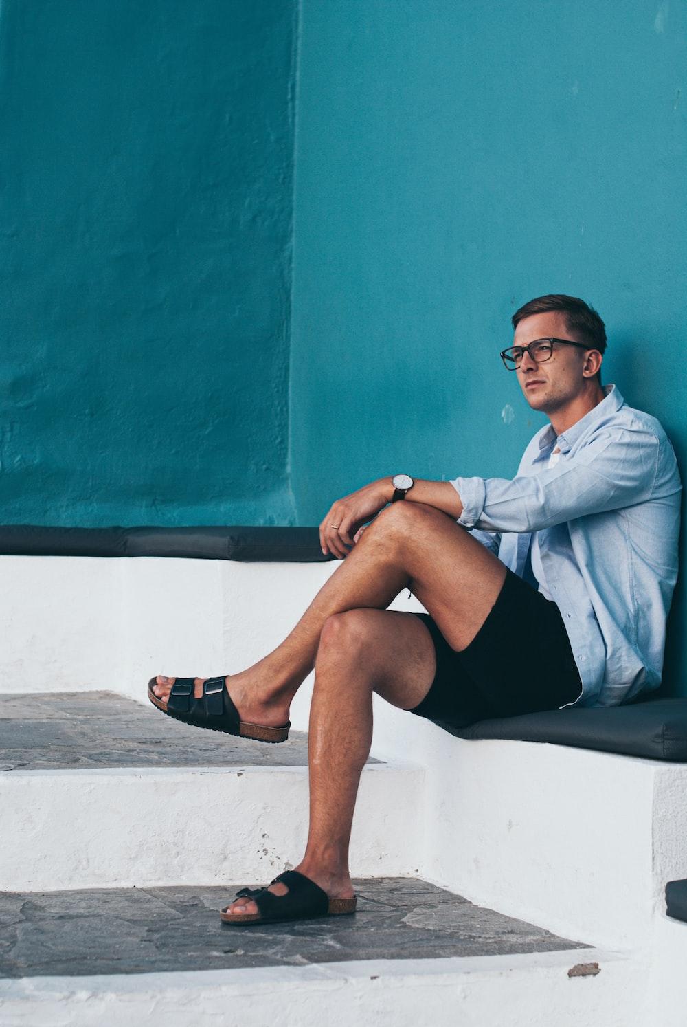 man sitting on white surface
