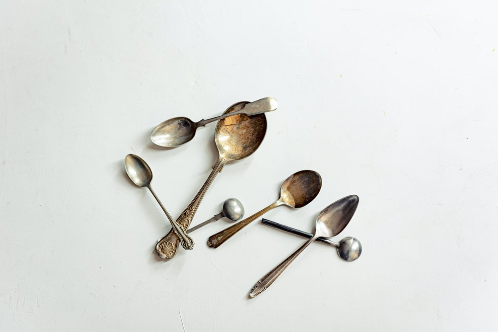 flat lay photography of silver spoons