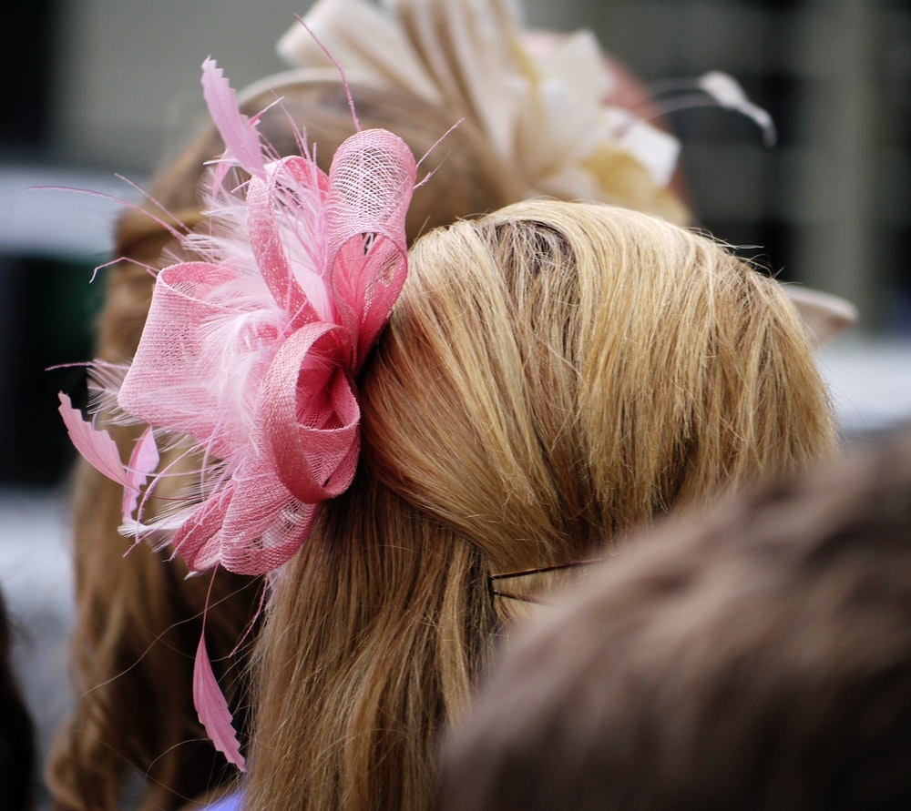 selective focus photography of pink headdress