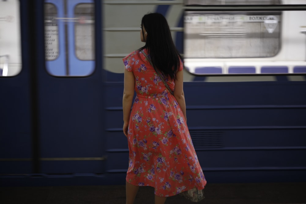 woman standing in front of train