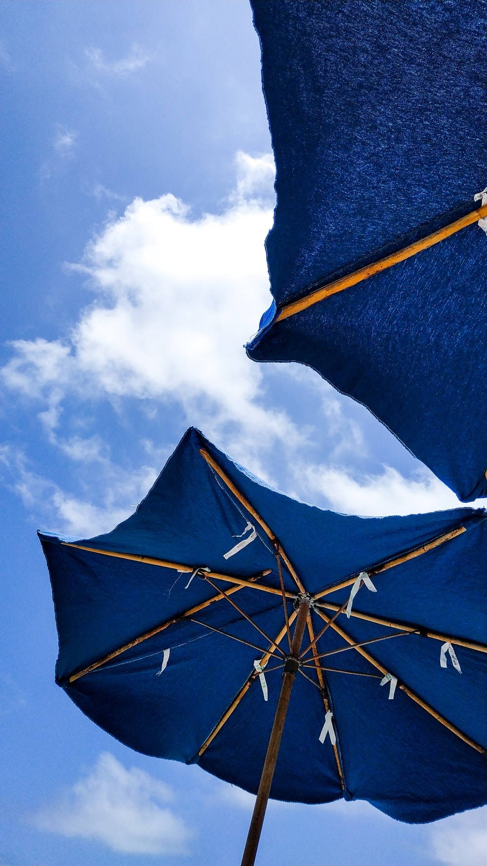 two blue umbrellas