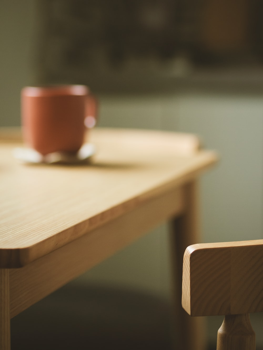brown wooden desk beside chair