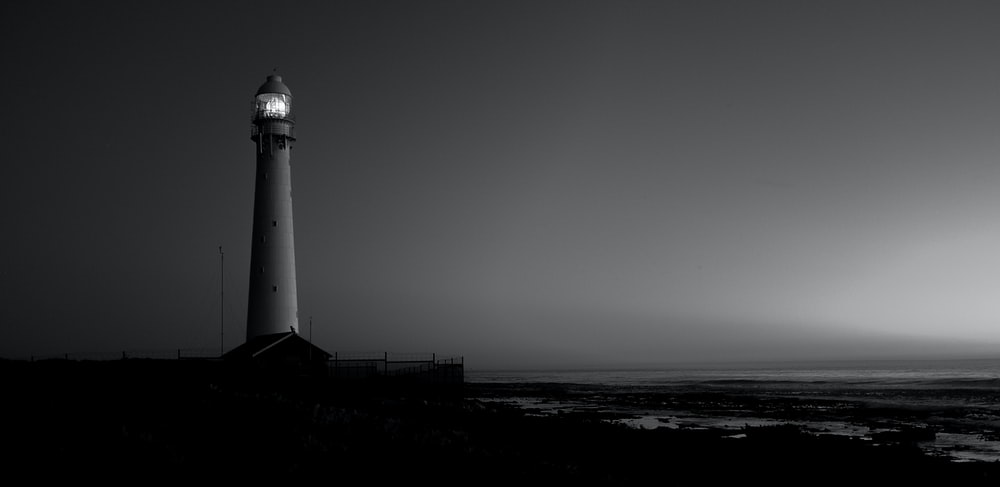 grayscale photo of lighthouse