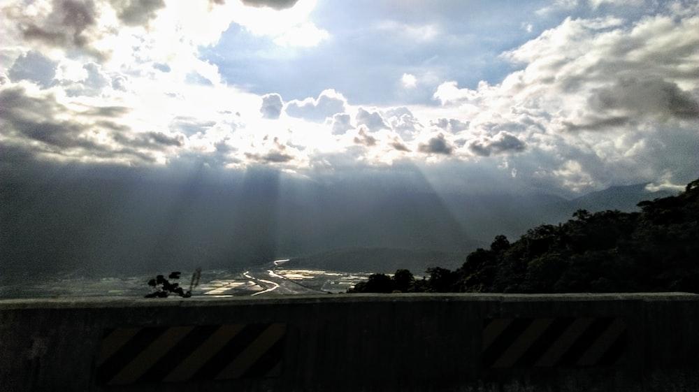 silhouette photography of bridge near trees