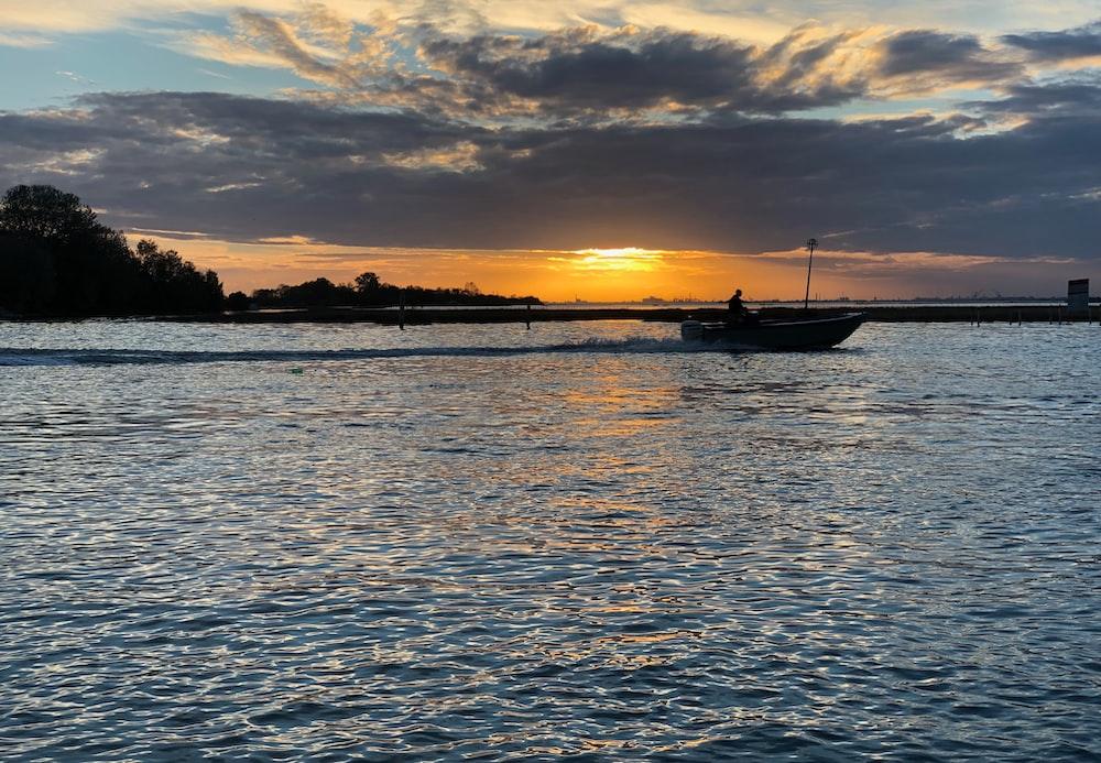 sailing boat during sunset
