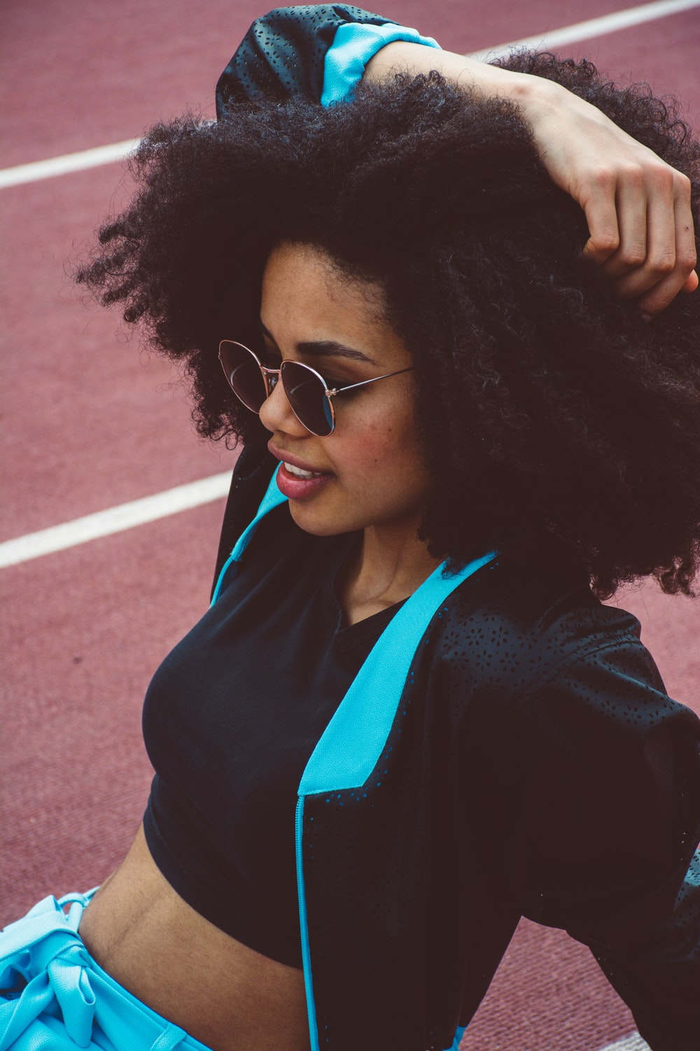 woman wearing black and teal jacket