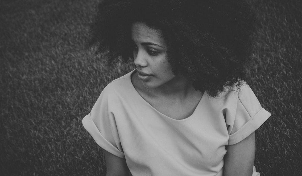 grayscale photo of woman wearing t-shirt